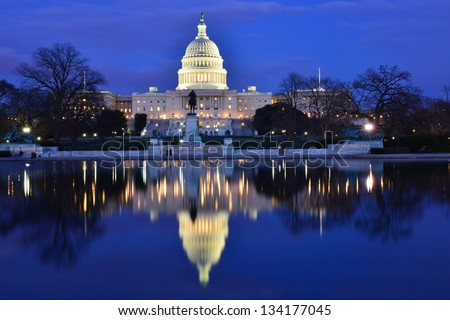 Capitol Building at dusk with reflection pool and blue sky, Washington DC, United States - stock photo