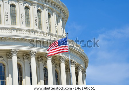 Capitol Building dome detail and waving American flag - Washington DC United States - stock photo