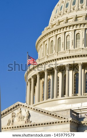 Capitol Building dome detail with US flag in Washington DC, United States