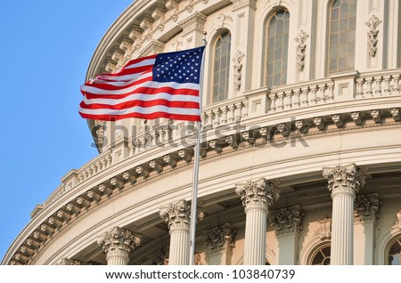 Capitol Building dome detail with US flag waving - stock photo
