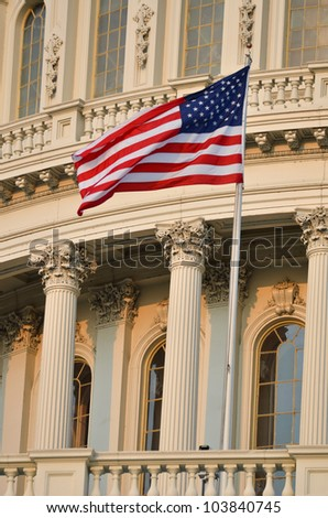 Capitol Building dome detail with US flag waving