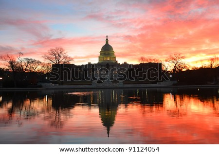 Capitol Building in a cloudy  sunrise with mirror reflection, Washington D.C. United States - stock photo