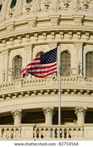 Capitol building in Washington DC USA - Close-up to dome and US flag - stock photo