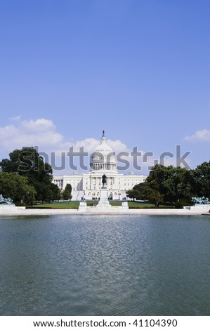 Capitol Building in Washington DC with water in foreground - stock photo