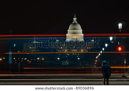 Capitol Building with car light trails and street lights, Washington DC USA - stock photo
