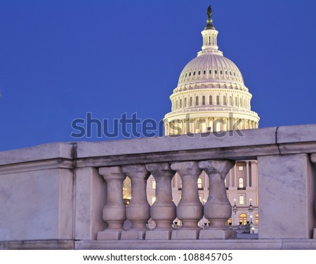Capitol dome behind the fence  at dusk - Washington, DC, USA - stock photo