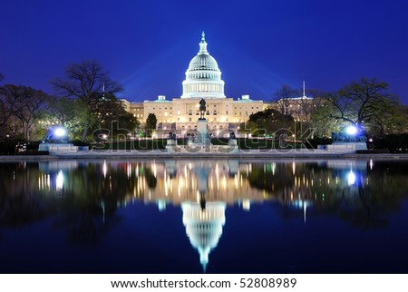 Capitol Hill Building at dusk with lake reflection and blue sky, Washington DC. - stock photo