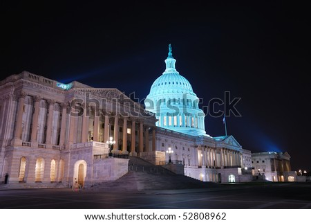 Capitol hill building at night illuminated with light, Washington DC. - stock photo
