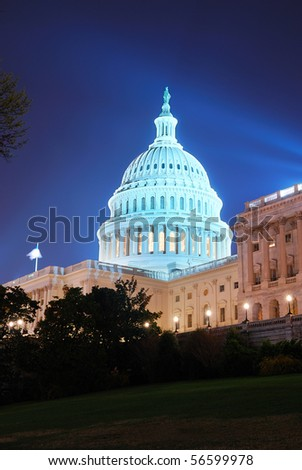 Capitol hill building at night illuminated with light, Washington DC.