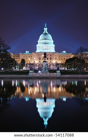 Capitol hill building at night illuminated with light with lake reflection, Washington DC. - stock photo