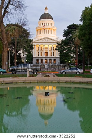 Capitol of California reflection in the water at sunset - stock photo