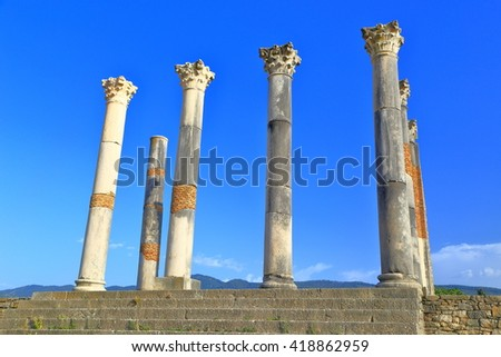 Capitolin Temple with tall columns under the blue sky in Volubilis, Meknes, Morocco