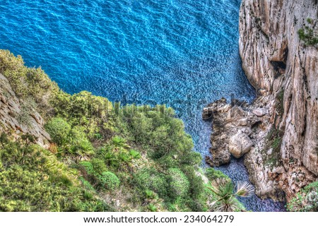 Capo Caccia shore with rocks and plants. Processed for hdr tone mapping effect. - stock photo