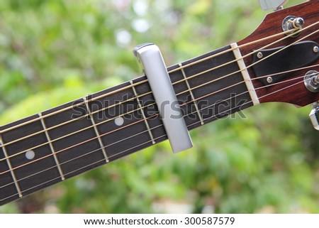 capo of guitar - stock photo