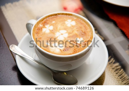 Cappuccino coffee close up at the table - stock photo