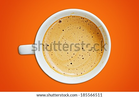 Cappuccino coffee cup and beans on a orange background - stock photo