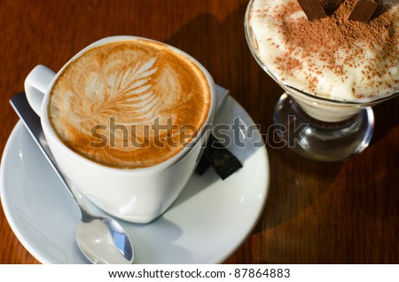Cappuccino coffee cup closeup at the table - stock photo