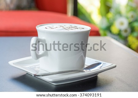 Cappuccino coffee cup in coffee cafe ,Hot coffee in white mug - stock photo