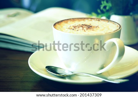 Cappuccino coffee cup in green vintage tone - stock photo