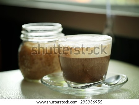 Cappuccino coffee cup on the table in a coffee shop. - stock photo