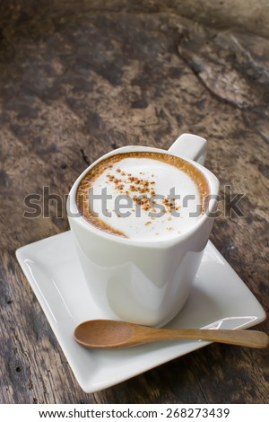 Cappuccino coffee cup on wood table
