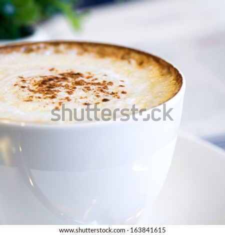Cappuccino coffee in a white cup