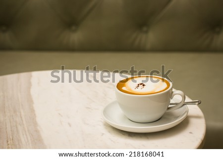 Cappuccino coffee in a white cup. coffee on table - stock photo