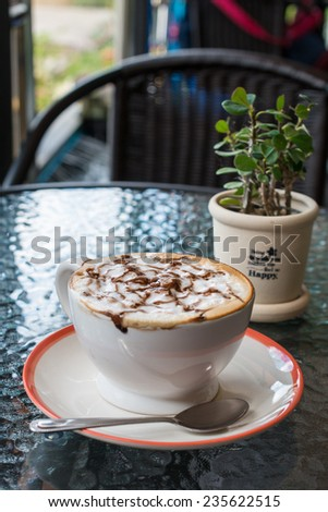 Cappuccino coffee in the chilling day - stock photo