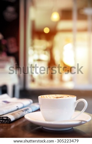 Cappuccino coffee on the table, vintage warm tone  - stock photo