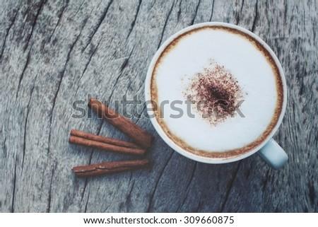 Cappuccino coffee with cinnamon sticks  - stock photo