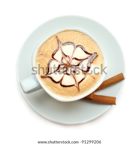 Cappuccino coffee with pattern of chocolate sauce isolated on white - stock photo