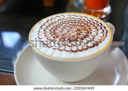 Cappuccino, cup of coffee on the morning - stock photo
