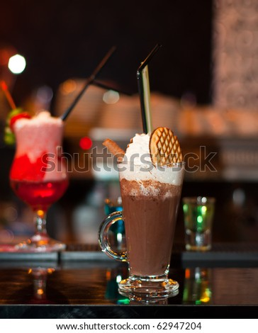 Cappuccino Frappe with fancy red cocktail on background - stock photo