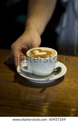 Cappuccino heart-shaped decoration - stock photo