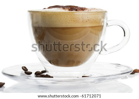 cappuccino in a glass cup with chocolate powder on white background - stock photo