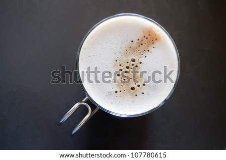 cappuccino in a glass on grey background