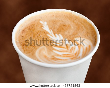 Cappuccino in a takeaway cup - stock photo