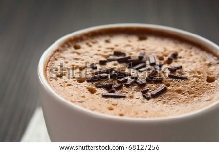 Cappuccino in white cup  with chocolate sprinkles - stock photo