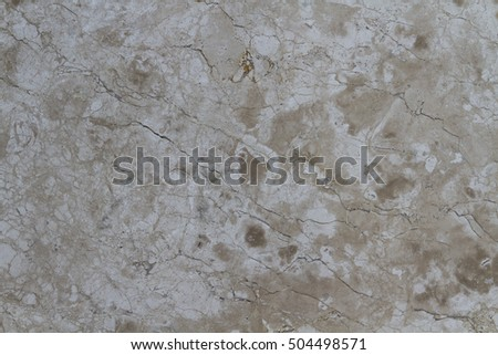 Cappuccino Marble texture delicate shades of coffee with milk. The unique pattern created by nature on a rock, closeup. Natural material for tiles, countertops, window sills and decorative details.