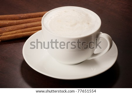 cappuccino on dark table - stock photo