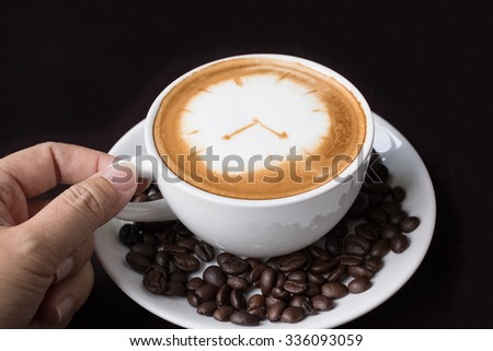Cappuccino or latte coffe in a white cup with heart shaped foam on wooden board - stock photo