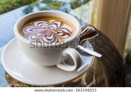 Cappuccino or latte coffee with flower shape.  - stock photo
