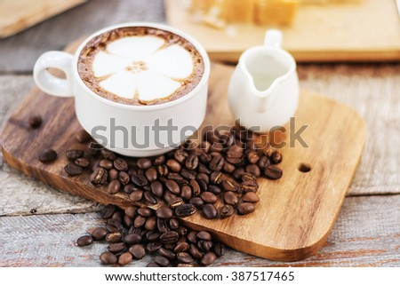 Cappuccino or latte coffee with flower shape, coffee lover, coffee for background - stock photo