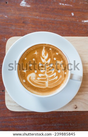 Cappuccino or latte coffee with tree shape - stock photo