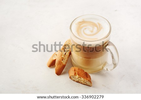 Cappuccino with biscotti or cantucci on a white table. Food background with copyspace - stock photo