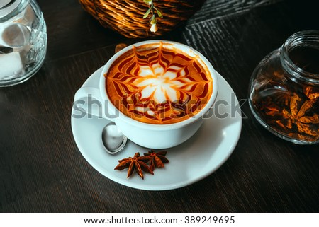 Cappuccino with cinnamon and anise - stock photo