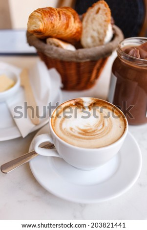 cappuccino with croissants - stock photo