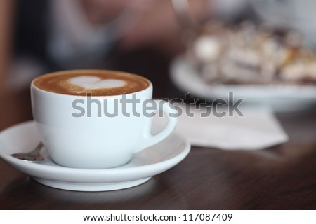 cappuccino with foam and heart - stock photo