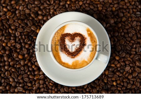 cappuccino with heart of cacao  - stock photo