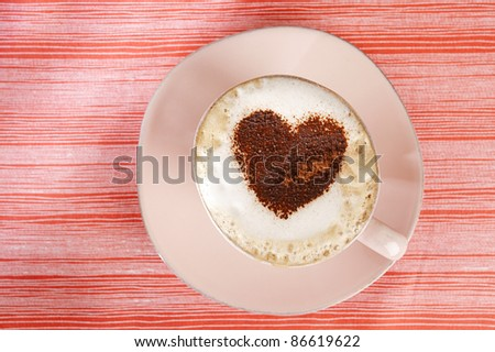 cappuccino with heart, red stripy backdrop - stock photo